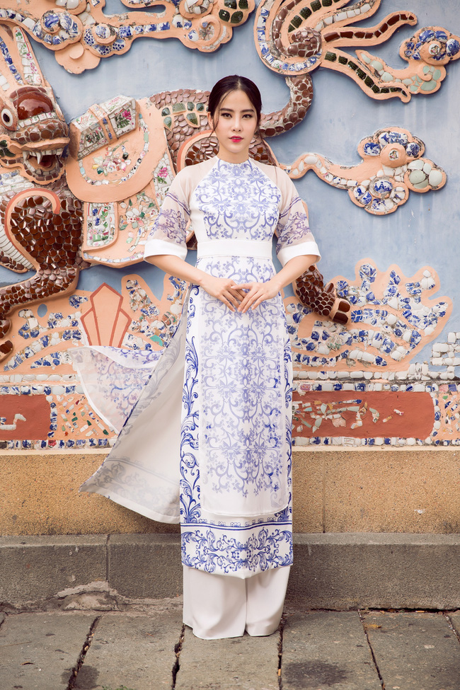 Hoa khôi Nam Em khoe vóc dáng nuột nà trong áo dài truyền thống - Ảnh 8.